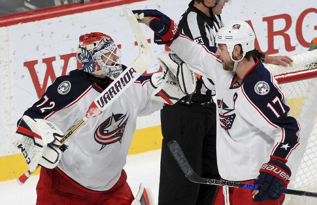 Columbus Blue Jackets goalie Sergei Bobrovsky (72) and center Brandon Dubinsky (17) celebrate after the team defeated the Minnesota Wild 4-2 during an NHL hockey game Saturday, Dec. 31, 2016, in St. Paul, Minn. (AP Photo/Andy Clayton-King)