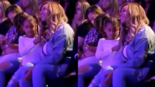 Watching Blue Ivy twirl Beyoncé's hair will melt your heart