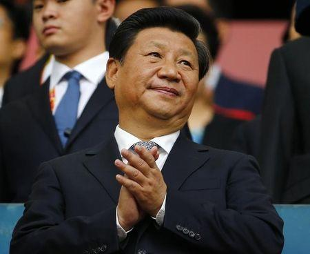 Chinese President Xi Jinping applauds during the opening ceremony of the 15th IAAF World Championships at the National Stadium in Beijing