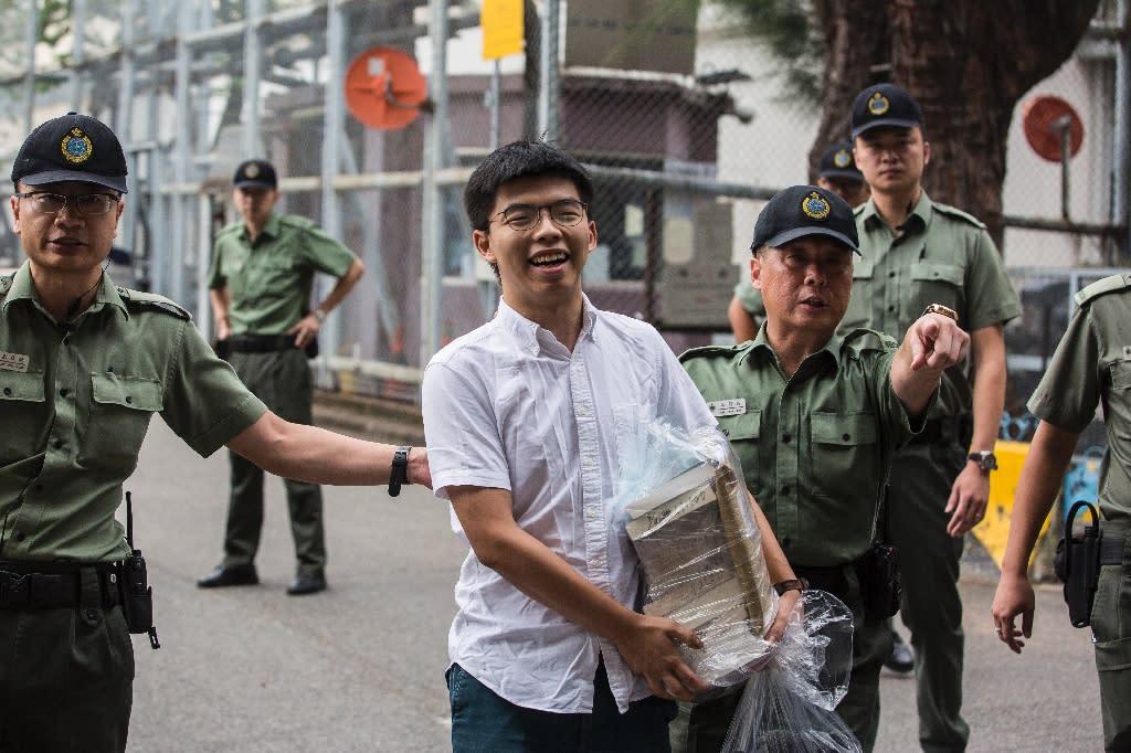 Hong Kong democracy activist Joshua Wong smiled as he walked free from prison (AFP Photo/ISAAC LAWRENCE)