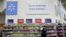 Walmart takes bruises from Amazon battle in fourth quarter