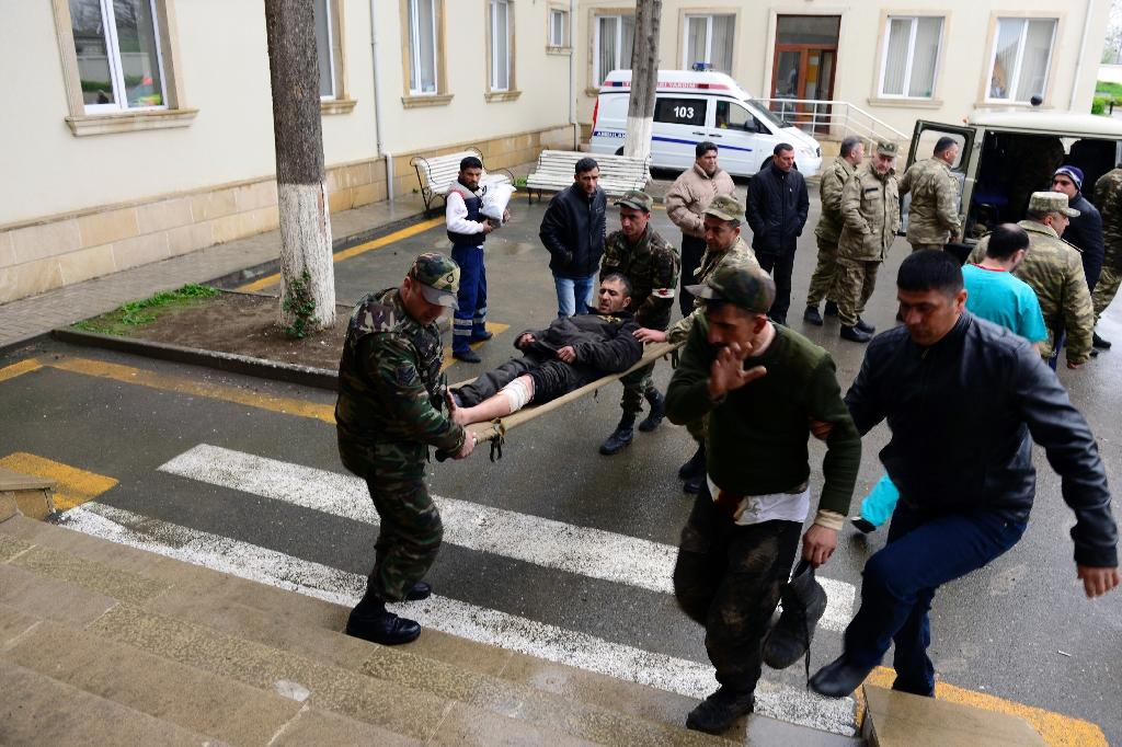 Azeri soldiers wounded in clashes in the Nagorny Karabakh are taken to hospital in the frontline town of Terter (AFP Photo/Tofik Babayev)