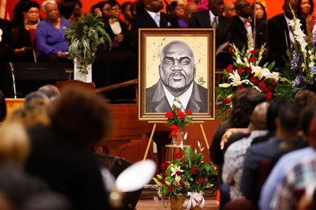 An artistic depiction of Terence Crutcher is displayed at his funeral in Tulsa