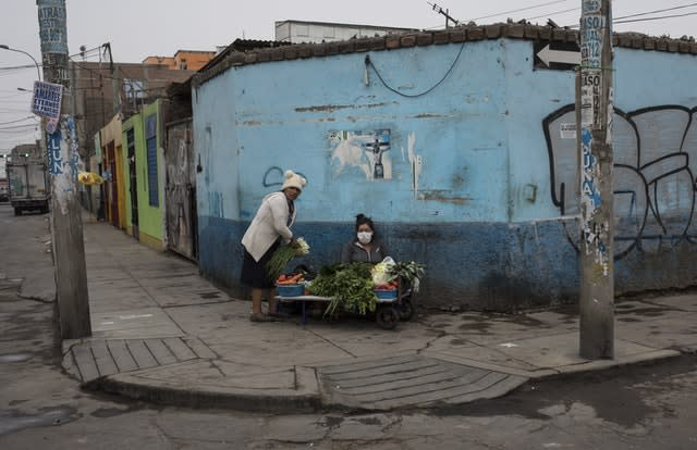 Street vendors sell vegetables in Lima, Peru (Rodrigo Abd/AP)
