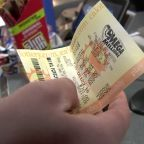Terrible odds not deterring Mega Millions hopefuls from buying tickets for chance at massive jackpot