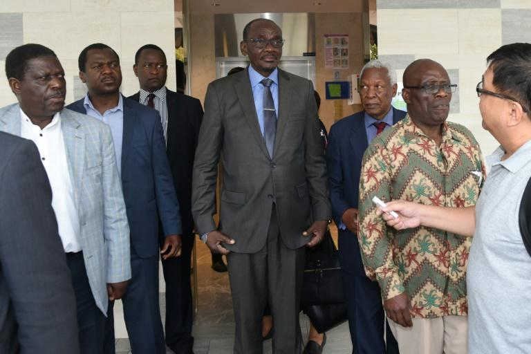 The group, including Vice President Kembo Mohadi (C), attended a private Catholic mass for Mugabe officiated by a Zimbabwean priest