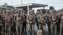 Trump says troops to remain at border 'as long as necessary'
