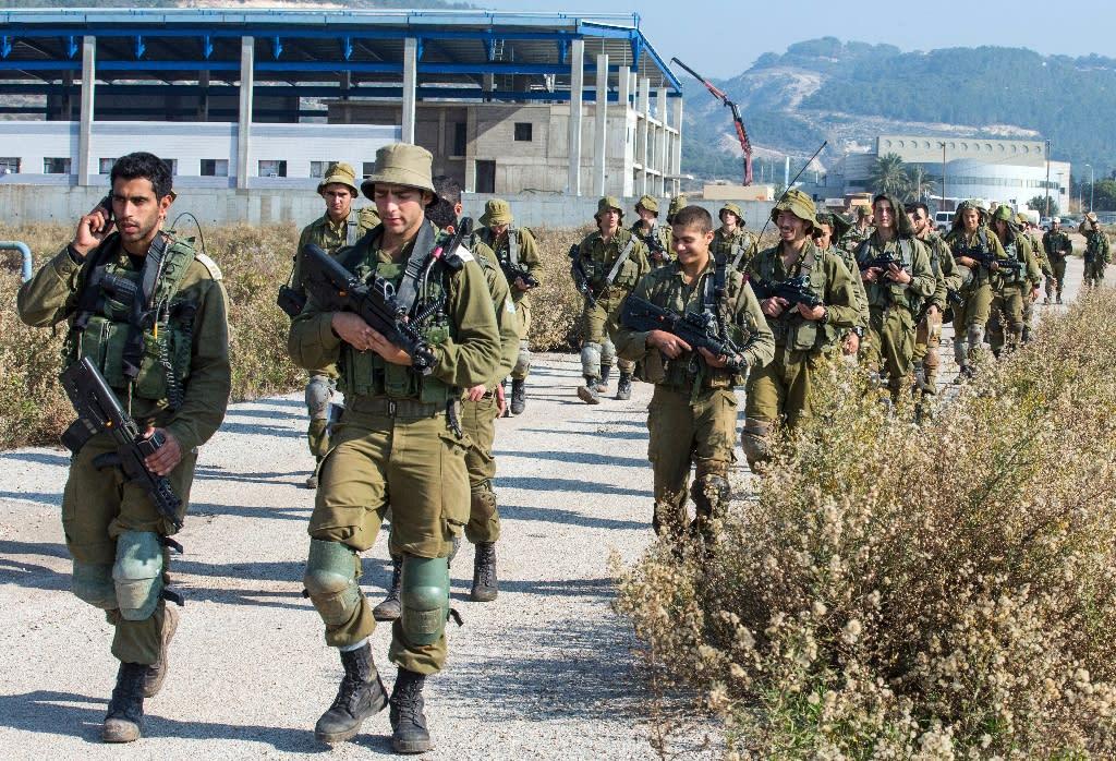 Israeli soldiers patrol the northern Israeli-Lebanon border on December 21, 2015