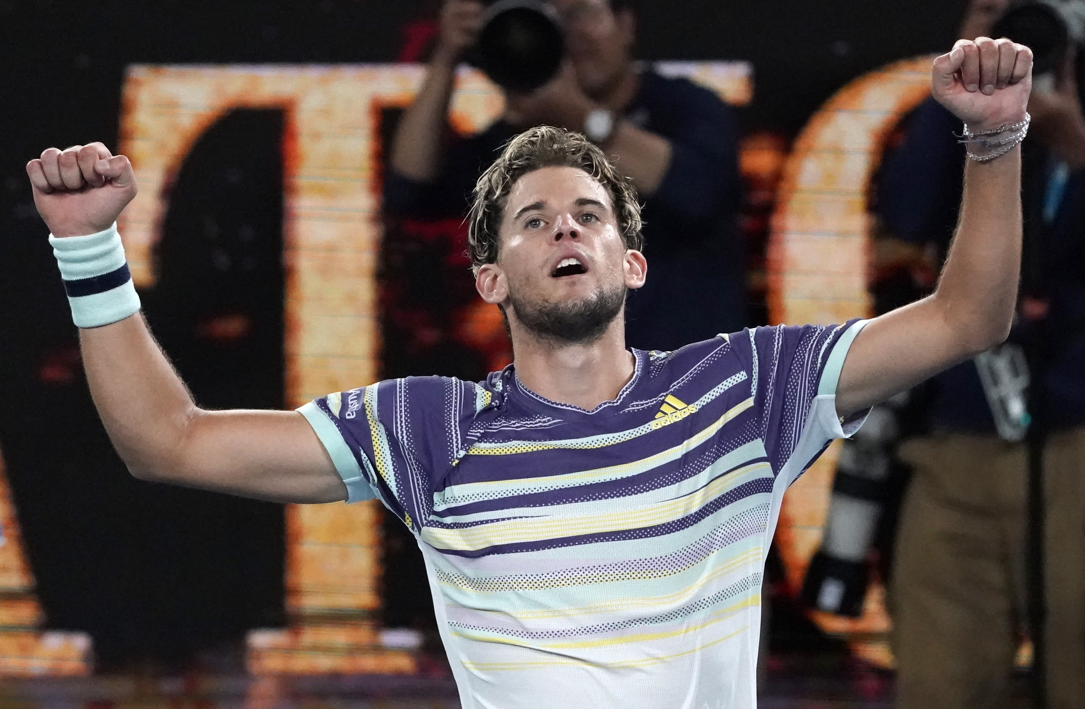 FILE - In this Jan. 31, 2020, file photo, Austria's Dominic Thiem celebrates after defeating Germany's Alexander Zverev in their semifinal match at the Australian Open tennis championship in Melbourne, Australia. Thiem is scheduled to play in the U.S. Open, scheduled for Aug. 31-Sept. 13, 2020.(AP Photo/Lee Jin-man, File)