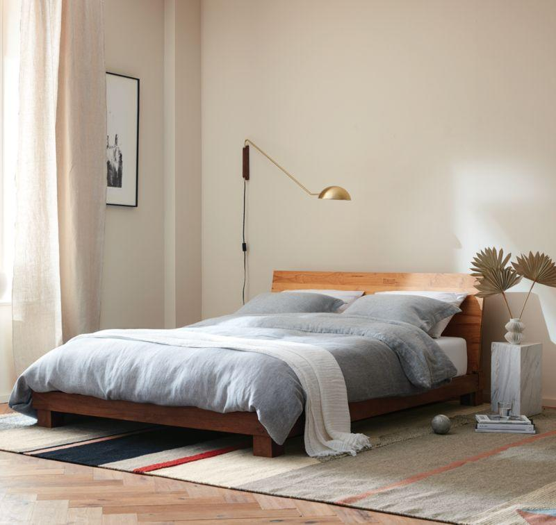 """<p>This platform bed is mindfully manufactured with sustainable mango wood and solid teak reclaimed from homes no longer in use in India. The striking teak has natural knows, splits, and markings and lends an earthen feel to any room. </p> <p><strong>Return Window:</strong> 90 days</p> <p><strong>Warranty:</strong> Not available</p> <p><strong>Customer Review:</strong> """"Absolutely love this bed. I purchased it about seven months ago and have been so happy with it. It's the type of piece that you can feel good about investing in due to its quality, durability, and a timeless and versatile aesthetic. In my California modern home it's a simple piece that speaks for itself, and looks great with my beige linen duvet. But in a few years when I'm ready for a refresh, this bed will easily translate well into a new design story. Amazing product, great customer support. Delivery and set up was amazing! It's worth the price, and is something that will last a lifetime!"""" <em>—Gabraelle</em></p> $899, CB2. <a href=""""https://www.cb2.com/dondra-queen-bed/s275398?localedetail=US"""" rel=""""nofollow noopener"""" target=""""_blank"""" data-ylk=""""slk:Get it now!"""" class=""""link rapid-noclick-resp"""">Get it now!</a>"""