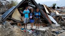 Indonesians seek talismans of former lives in quake rubble