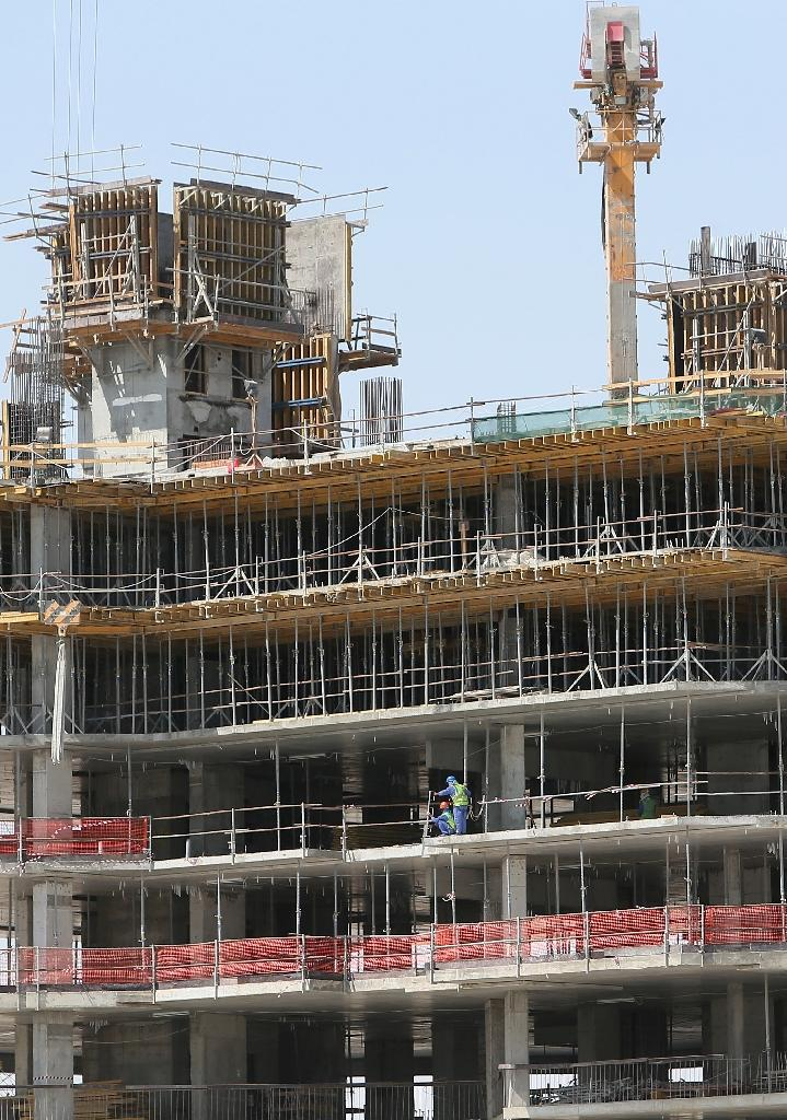 From August 18, 2015, Qatar's companies which fail to pay staff on time could face fines of up to 6,000 Qatari riyals ($1,650), be banned from recruiting new staff and bosses potentially sent to jail (AFP Photo/Karim Jaafar)
