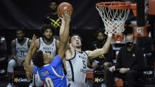 Oregon beats UCLA 82-74, moves into first in Pac-12