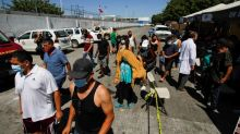 U.S. may offer COVID vaccine to migrants crossing from Mexico -Washington Post