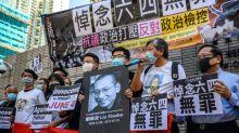 Leading Hong Kong activists charged for Tiananmen vigil gathering