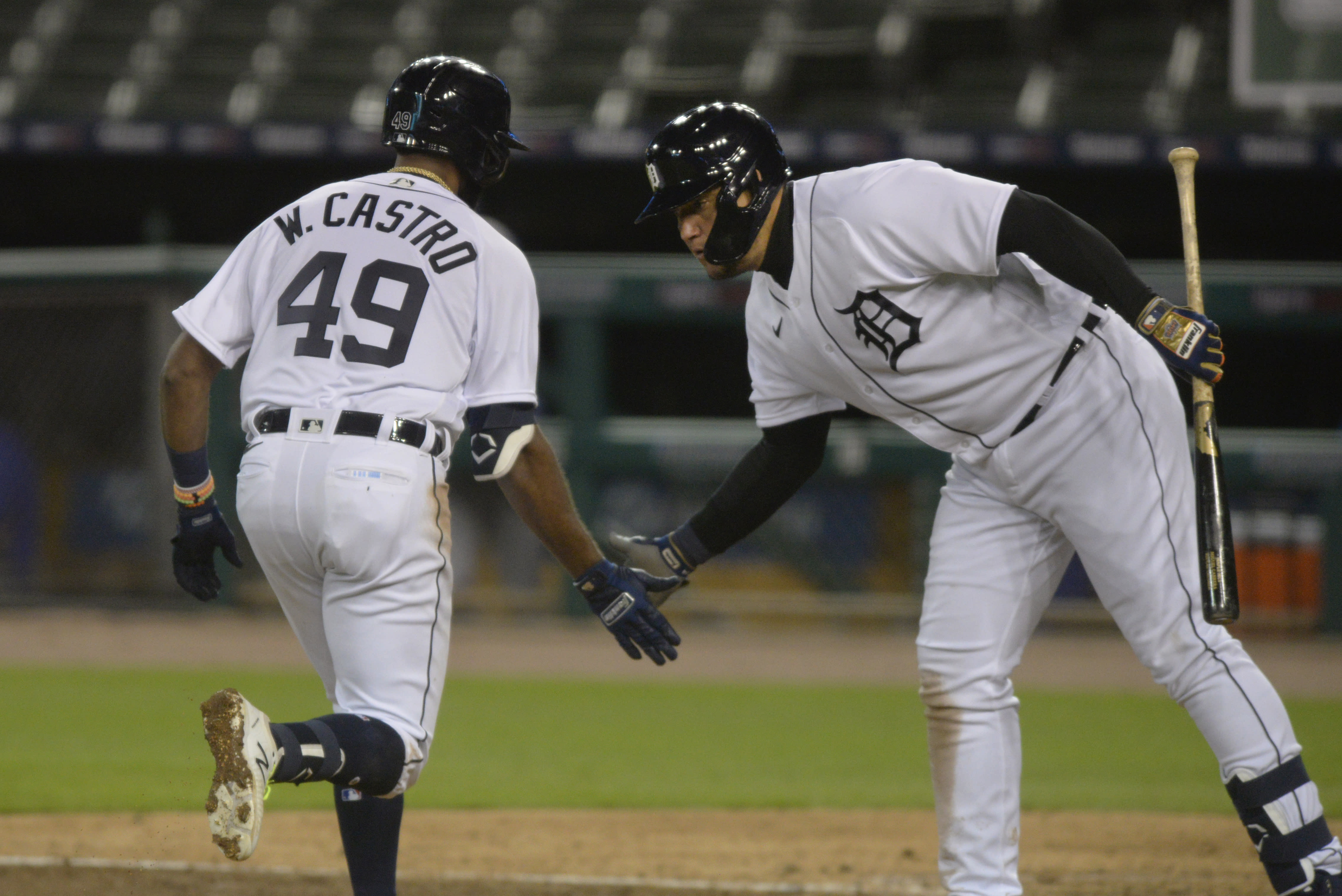 Detroit Tigers' Willi Castro is congratulated by Miguel Cabrera after hitting a home run against the Kansas City Royals during the sixth inning of a baseball game Tuesday, Sept. 15, 2020, in Detroit. The Tigers won 6-0. (AP Photo/Jose Juarez)