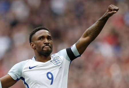 England's Jermain Defoe celebrates scoring their first goal