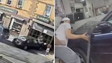 Incredible footage shows police pull baby out from under car