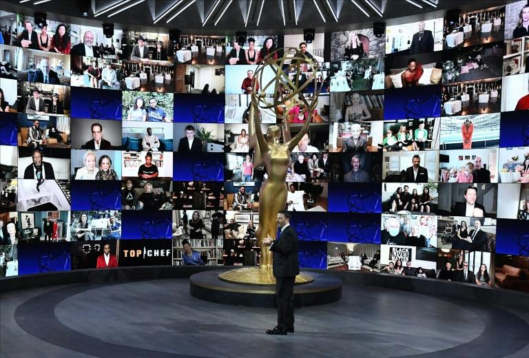 Emmys host Jimmy Kimmel -- at the Staples Center in Los Angeles -- stands in front of a wall of screens showing nominees taking part in the ceremony from home