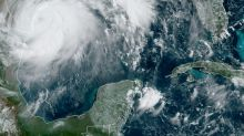 Hurricane Hanna downgraded to tropical storm as it lands in virus-hit Texas