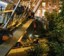Dozens of Hong Kong protesters make daring campus breakout