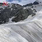 Watch as this Massive Italian Glacier Covered in Sheets to Prevent the Melting of Ice