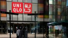 Uniqlo owner trims profit forecast on new COVID-19 curbs