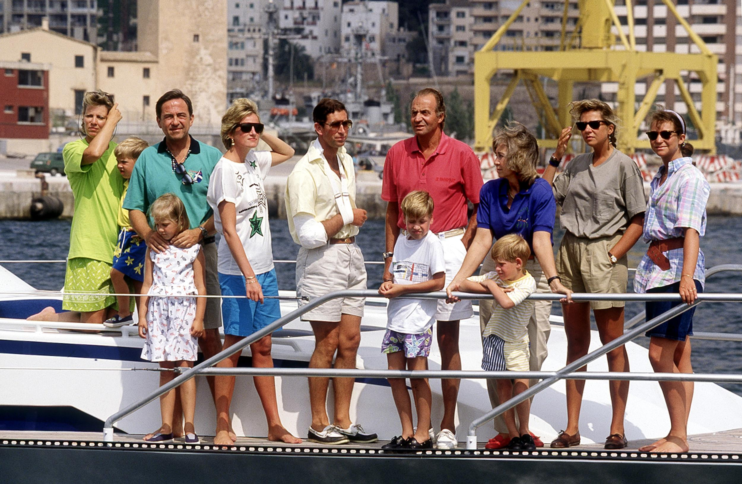 European royalty on King Juan Carlos of Spain's motor cruiser during a family holiday in Palma de Mallorca, August 1990. From left to right, Queen Anne Marie of Greece, Prince Philippos of Greece, ex-King Constantine of Greece with Princess Theodora, Princess Diana, Prince Charles, King Juan Carlos of Spain with Prince William, Queen Sophia of Spain with Prince Harry, Princess Cristina of Spain and Princess Elena of Spain. (Photo by Jayne Fincher/Princess Diana Archive/Getty Images)