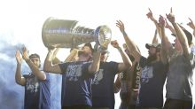 Lightning players allow paraders to sample drinks from Stanley Cup at celebration