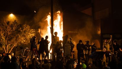 Protesters set fire to Minn. police precinct