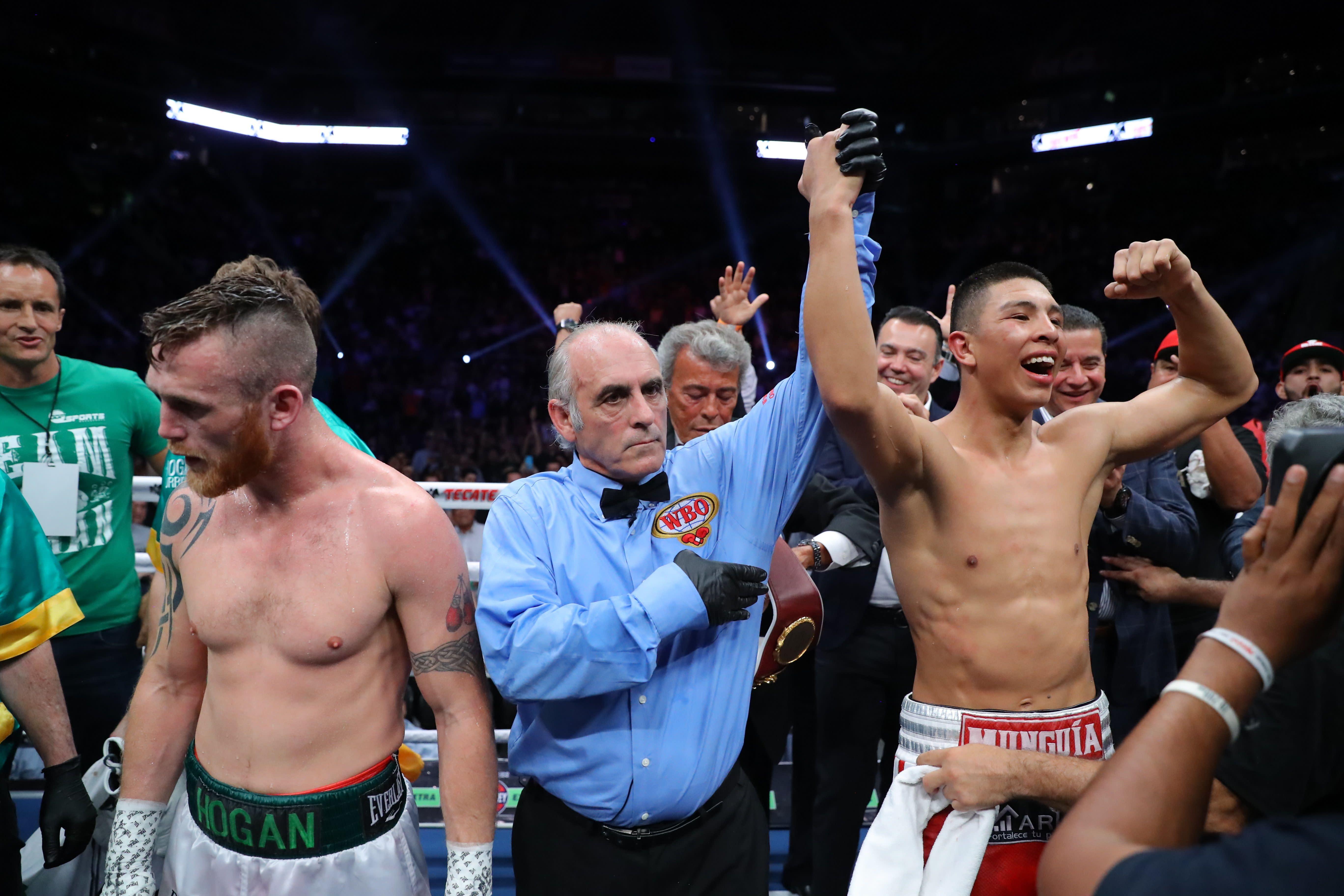 Jaime Munguia (R) celebrates his victory over Dennis Hogan on April 13, 2019 at Arena Monterrey in Monterrey, Mexico. (Getty Images)