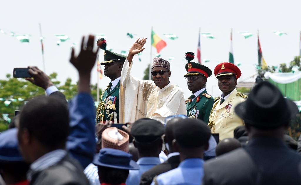 Nigerian President Muhammadu Buhari (C) waves to the crowd during his inauguration ceremony as President of Nigeria, in Eagle Square in Abuja, May 29, 2015