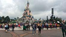 Disneyland Paris reopens, but no hugs for Donald