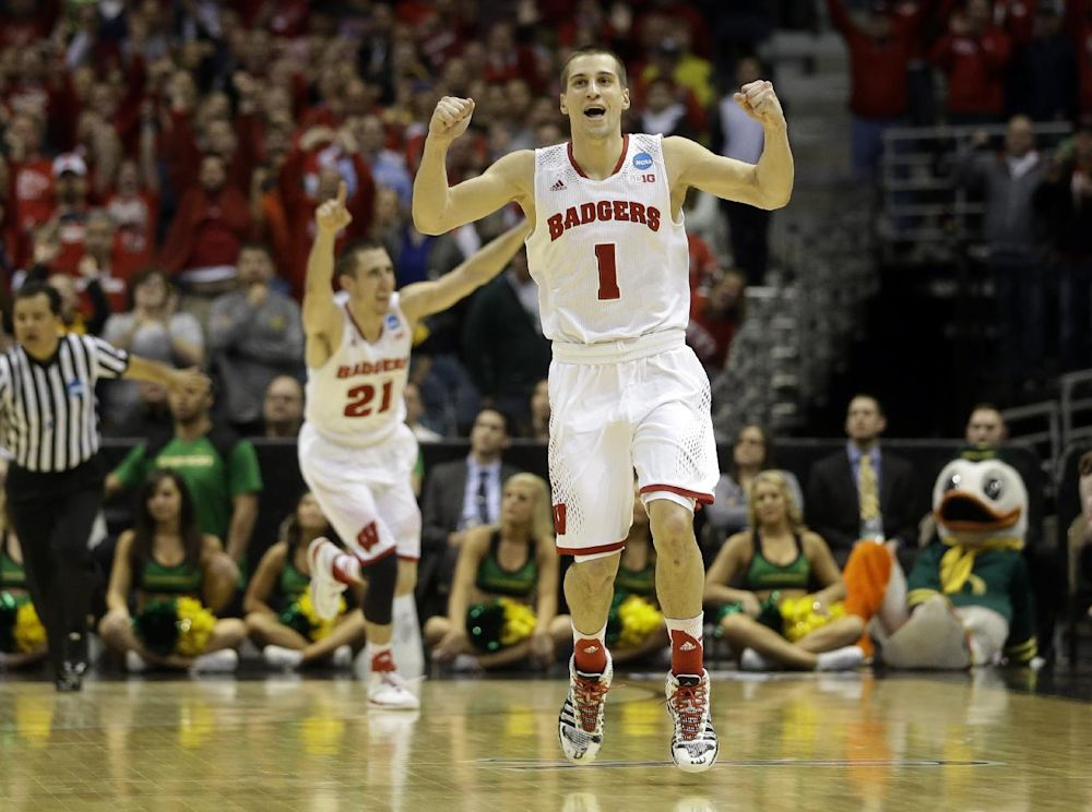 Wisconsin guards Ben Brust (1) and Josh Gasser (21) react to a foul call against Oregon during the second half of a third-round game of the NCAA college basketball tournament Saturday, March 22, 2014, in Milwaukee. Wisconsin won 82-77
