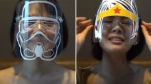 Thai woman makes plastic face shields with cartoon characters
