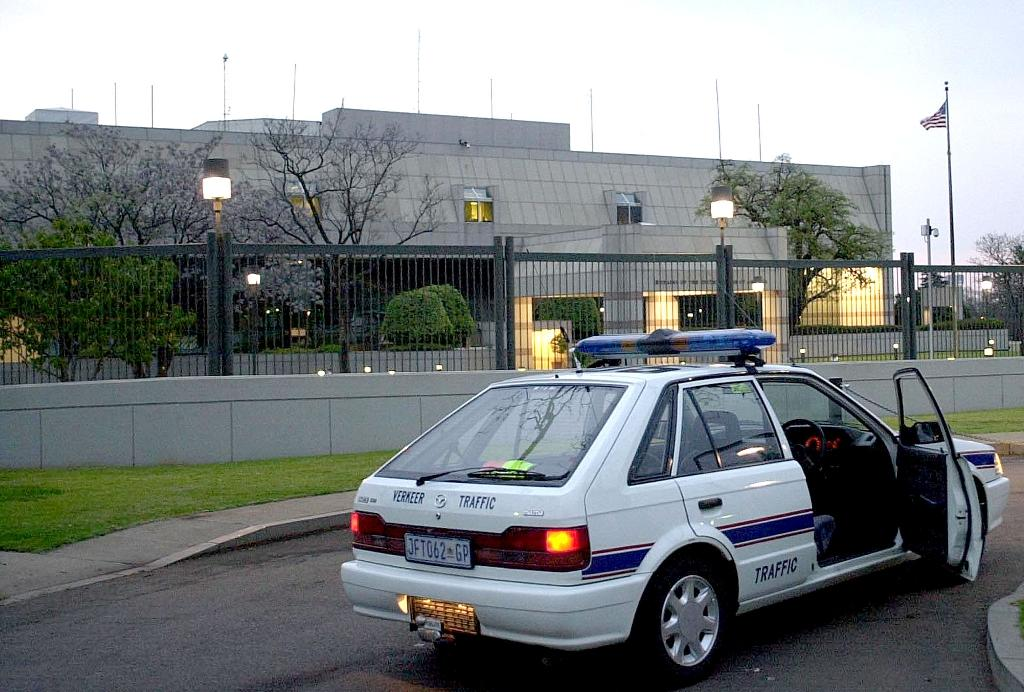 A South African police car is parked September 11, 2001 in front of the United States embassy in Pretoria as extra security steps are taken all around the world to secure American embassies (AFP Photo/Nerrisa Korb)