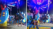 Terrifying moment revellers are flung from fairground ride when mechanical arm breaks
