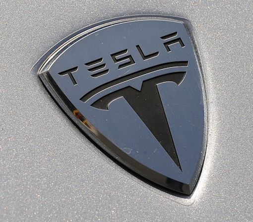 Speedy new Tesla boasts range topping 300 miles