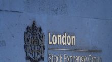 UK stocks end higher as economic recovery hopes build