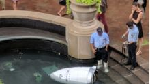 Mystery as robot policeman 'drowns itself' in nearby fountain