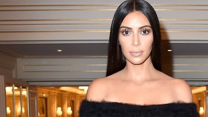 Kim K. drops suit over fake robbery claims