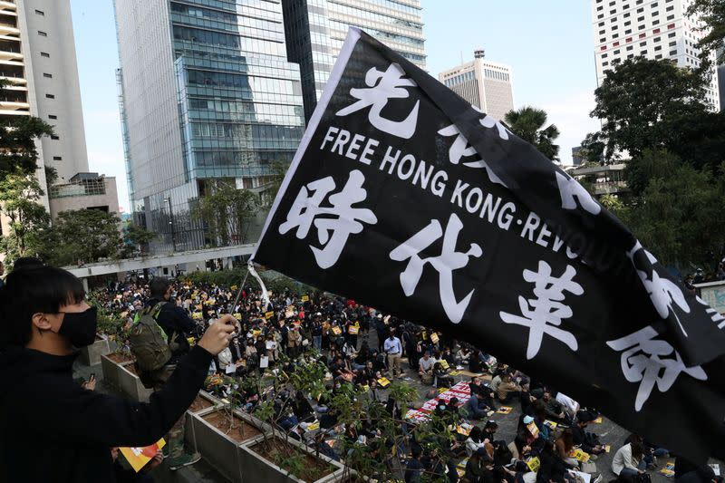 Hong Kong leader condemns U.S. law and promises economic relief