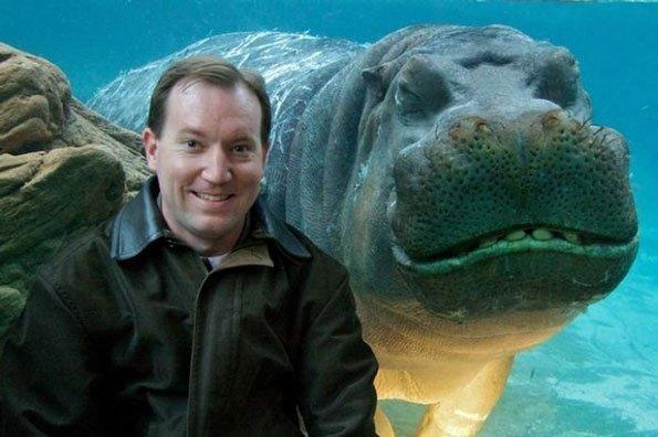 <p>This happy hippo certainly isn't camera shy, flashing his pearly whites alongside this equally smiley tourist.</p>  <p></p>