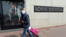 Sales drop at Vuitton owner LVMH as virus forces store closures