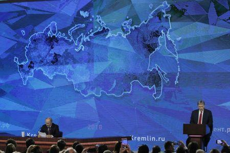 Russian President Putin and Kremlin spokesman Peskov attend annual news conference in Moscow