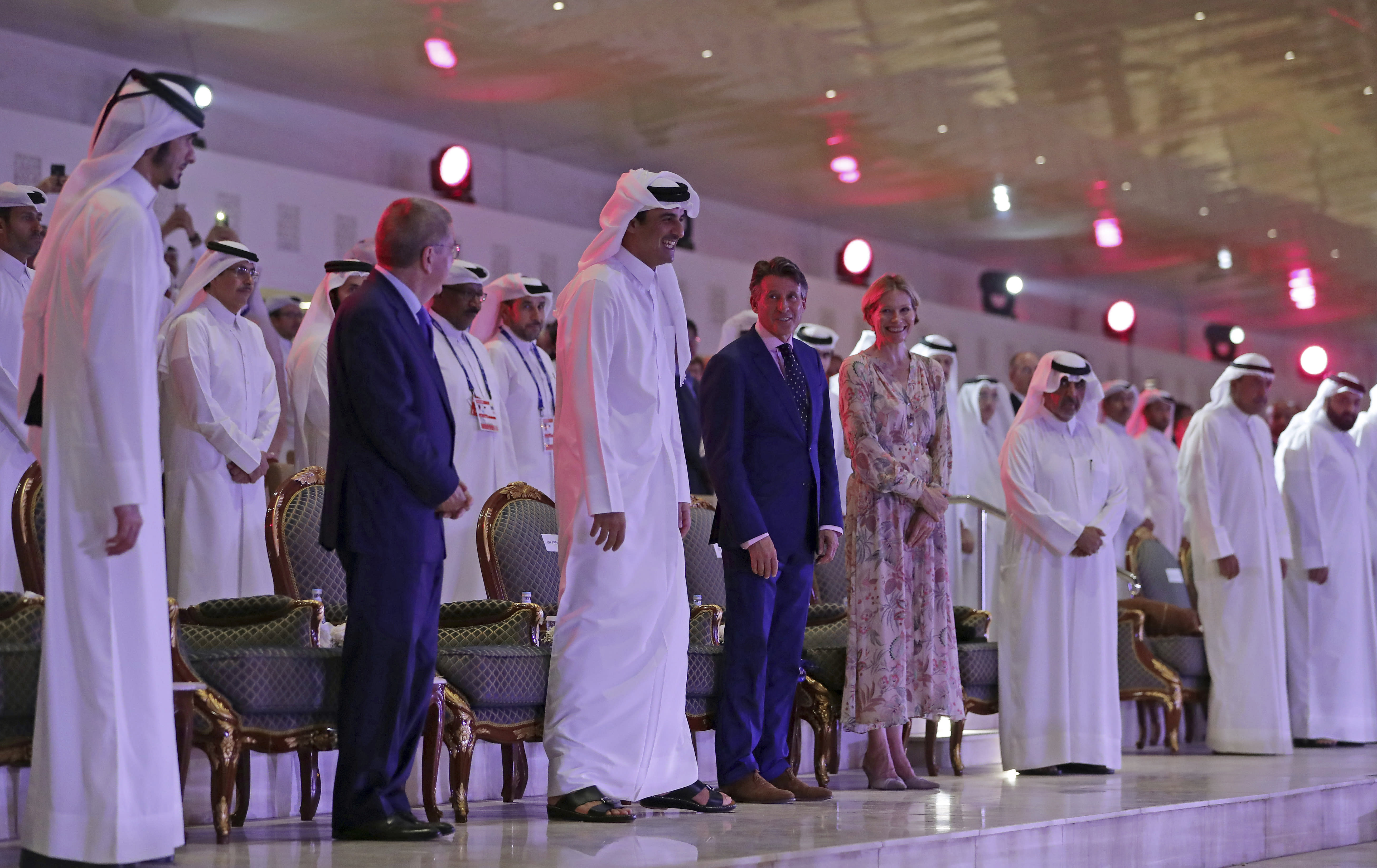 IOC president Thomas Bach, Emir of Qatar Sheikh Tamim bin Hamad Al Thani and IAAF President Sebastian Coe during the opening ceremony for the World Athletics Championships on the Corniche in Doha, Qatar, Friday, Sept. 27, 2019. (AP Photo/Hassan Ammar)