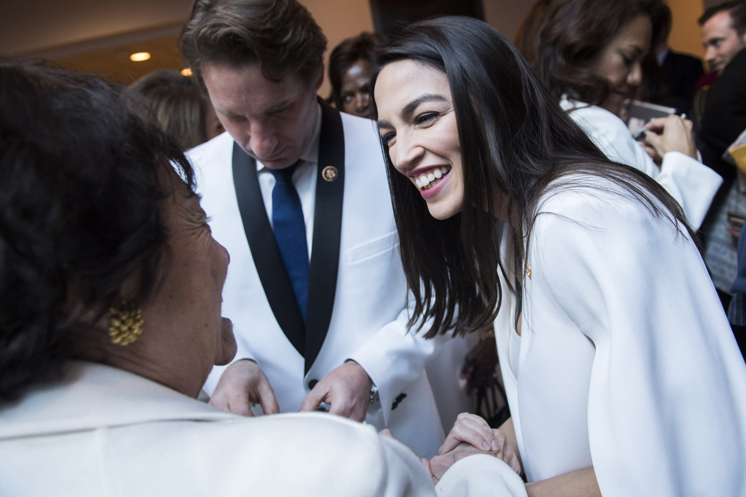 UNITED STATES - FEBRUARY 05: Rep. Alexandria Ocasio-Cortez, D-N.Y., right, greets Rep. Nita Lowey, D-N.Y., after a group photo of House Democrats in the Capitol Visitor Center who will wear 'suffragette white' to the State of the Union address to show solidarity for women's agendas on Tuesday, February 5, 2019. (Photo By Tom Williams/CQ Roll Call)