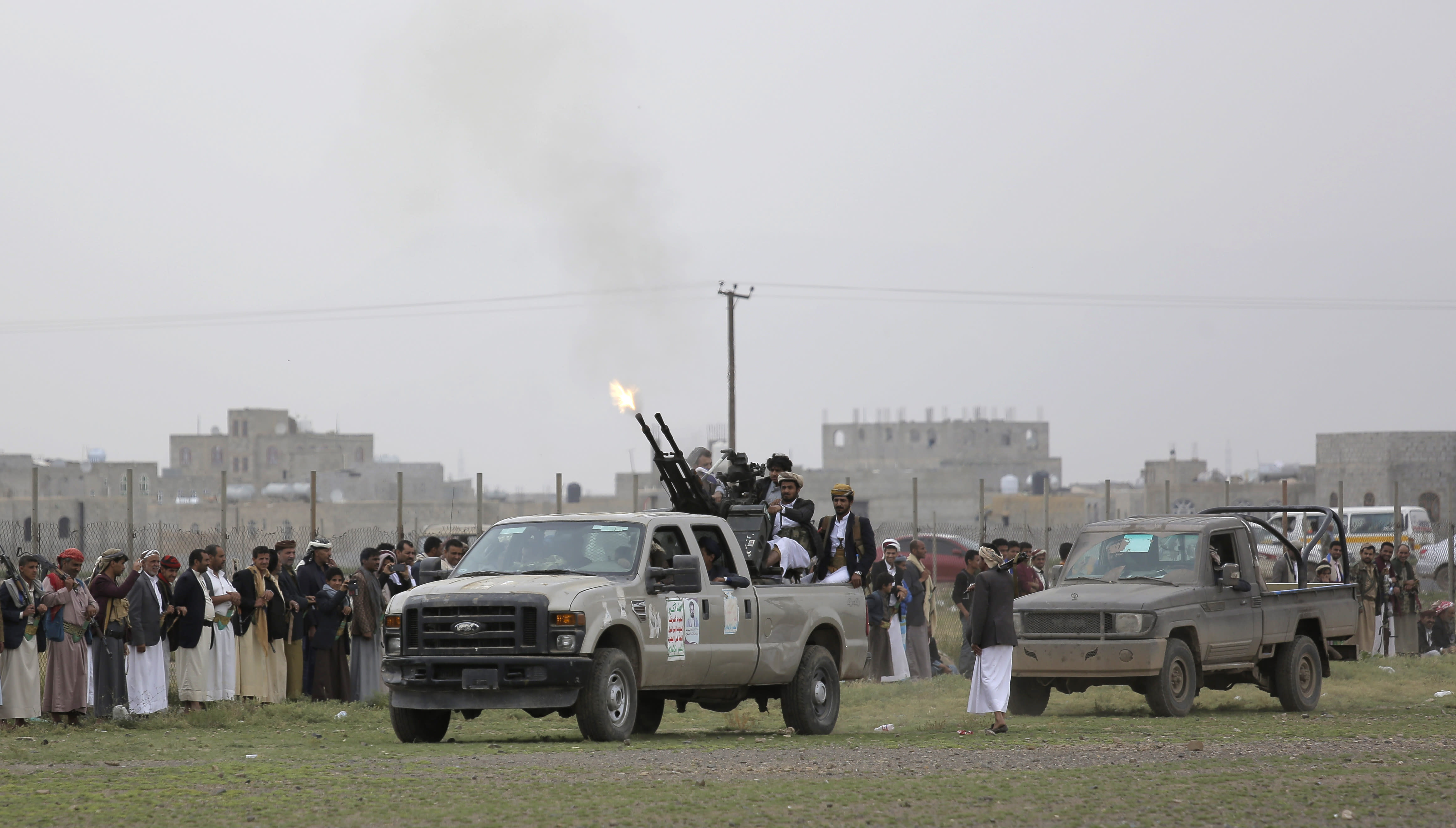 Houthi rebel fighters fire their weapons in the air as they take off to a battlefront following a gathering aimed at mobilizing more fighters for the Houthi movement, in Sanaa, Yemen, Thursday, Aug. 1, 2019. The conflict in Yemen began with the 2014 takeover of Sanaa by the Houthis, who drove out the internationally recognized government. Months later, in March 2015, a Saudi-led coalition launched its air campaign to prevent the rebels from overrunning the country's south. (AP Photo/Hani Mohammed)