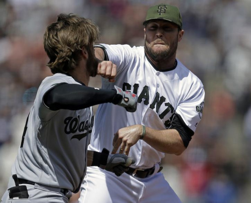 Bryce Harper (left) prepares to hit Hunter Strickland after being hit with a pitch on Memorial Day 2017. (AP)