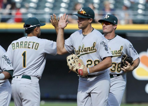 A's rookies Franklin Barreto (left), Matt Olson (center) and Jaycob Brugman (right) celebrate their historic and a big 10-2 win in Chicago. (AP)